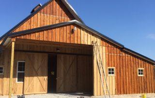 Barn undergoing wood staining